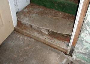 A flooded basement where water entered through the hatchway door