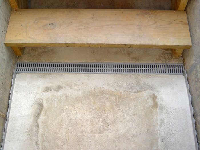 Our Grated Drain System Installed On A Leaking Basement Staircase.